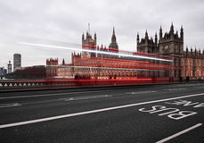 Big Ben at night. With light trails of passing buses Royalty Free Stock Image