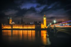 Big Ben at night with the lights of the cars in London city Royalty Free Stock Images