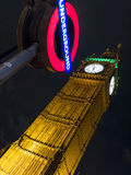 Big Ben at night. Big Ben in London at night with the Westminster tube station sign Stock Photos