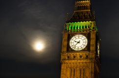Big Ben at night. The very famous London Icon of Big Ben Tower photographed at night whit a cloudy moon in the sky Royalty Free Stock Image