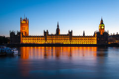 Big Ben with the Parliament at dusk in London. A high resolution night view of Big Ben with the Palace of Westminster from the South Bank of the Thames in London Royalty Free Stock Photos