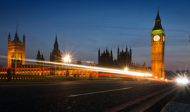 Big Ben and Parliament at night. Big Ben at the Houses of Parliament in London at night with road lights.  Long exposure Stock Images