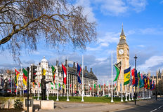 Big Ben, Parliament Square and flags Stock Images