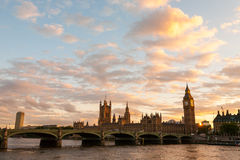 Big Ben and the Parliament with Westminster Bridge in London at sunset. Golden Big Ben and Skyline Royalty Free Stock Image