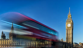Big Ben and passing red bus in London, United Kingdom Stock Images