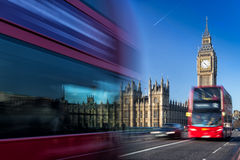 Big Ben and passing red buses, London, United Kingdom Royalty Free Stock Photo