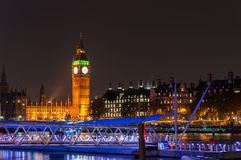 Big Ben and pier on River Thames at night Stock Photos
