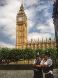 Big Ben With Policeman in Helmets. Big Ben Parliament With Two Policeman in Stock Photo