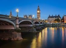 Big Ben, Queen Elizabeth Tower and Wesminster Bridge Illuminated Stock Photos