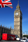 Big Ben with red bus in London, UK Stock Photos