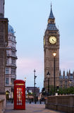 Big Ben and red London call box in the early morning Royalty Free Stock Image