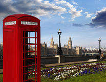 Big Ben with red phone booth in London, England Royalty Free Stock Photography