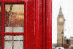 Big ben and red phone cabine. Rainy day Stock Images