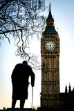 Big Ben and Sir Winston Churchill at Westminster in London Royalty Free Stock Photography