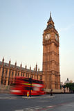 Big Ben & Speeding London Bus in Early Morning Stock Images