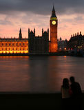 Big Ben Sunset. Couple looking out over Big Ben in London at sunset Royalty Free Stock Photography
