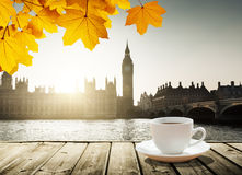 Big Ben at sunset and cup of coffee, London, UK Royalty Free Stock Images