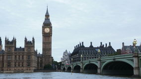 Big Ben and Thames river flowing under the bridge stock footage