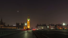 Big Ben time lapse at night in London. Big Ben time-lapse on the Westminster Bridge in London at Night with the Moon stock video footage
