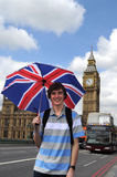 Big Ben and tourist with British flag umbrella in London Stock Images