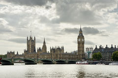 Big Ben Tower Bridge and Houses of Parliament. View of Big Ben and the Houses of Parliament on the River Thames in a typical cloudy day, London Royalty Free Stock Photo