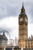 Big Ben tower with the London Eye in the background in London, UK Royalty Free Stock Images