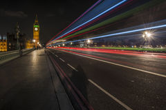 The Big Ben tower. The Big Ben at night and light trails, London, UK Royalty Free Stock Photo