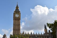 Big Ben Tower and sky with clouds. Big Ben Tower, part of the Palace of  Westminster London, Europe and blue sky with clouds above Royalty Free Stock Image
