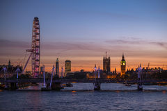 Big Ben tower, Westminster Abbey and London Eye. At the sunset Stock Photography