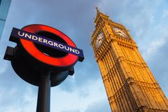 Big Ben and Undergraund. LONDON - MAY 08 2009:  The London 'Underground' sign and 'Big Ben' tower at evening on May 08 2009 in London. The Underground serves 270 Royalty Free Stock Photography