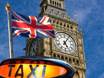 Big Ben and Union Jack. Taxi sign ,Union jack flagon pole  and Big Ben Royalty Free Stock Image