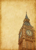 Big Ben. Upper portion of the tower, London,  Added paper texture Royalty Free Stock Photo