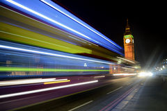 Big Ben view with a double decker in motion. View of the Big Ben while a double decker bus was passing, creating a beautiful lights trail in a long exposure Stock Photography