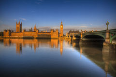 Big Ben and Westminister Abbey London. Big Ben and Westminster in morning light with reflection on Thames, London, England Stock Photo
