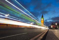 Big Ben on westminster bridge. A light trail of a bus going over westminster bridge with the houses of parliament in the frame royalty free stock images