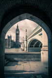 Big Ben and Westminster Bridge. Through an archway by the Thames (split toned Stock Photos