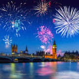 Big Ben and Westminster Bridge in London at night, UK. Fireworks display over the Big Ben and Westminster Bridge in London, UK Royalty Free Stock Photos