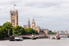 Big Ben, Westminster Bridge, And A Red Double Decker Bus Crossin Royalty Free Stock Photos