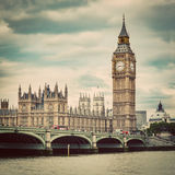 Big Ben, Westminster Bridge on River Thames in London, the UK. Vintage. Big Ben, Westminster Bridge on River Thames in London, the UK. English symbol. Vintage Royalty Free Stock Images