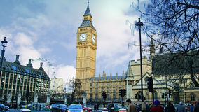Big ben in Westmister. Traffic and people near Westminster Palace Royalty Free Stock Image