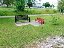 Big Bench, Little Bench. Big black bench and little red bench sitting beside each other Stock Image