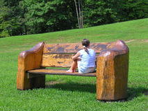 Big bench or little girl Stock Photography
