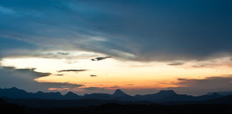 Big Bend Sunset. Sunset photo taken in Big Bend National Park showing a mountain range in the horizon Royalty Free Stock Image