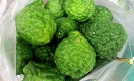 Big Bergamot. Fresh big bergamot, Green fruits in white plastic bag, Herb at Thailand stock images