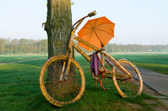 A big bicycle with an umbrella royalty free stock image