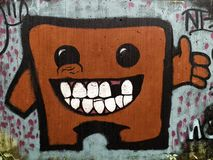 Big Big Smiley - Street Painting. This picture is a street painting of a laughing red comic figure Royalty Free Stock Image