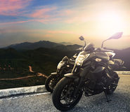 Big bike ,motorcycle parking on top of mountain with sun light o Royalty Free Stock Photo