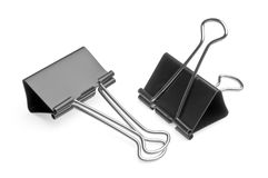 Big binder clips for paper. Two big black binder clips for paper on a white background Stock Photography