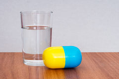 Big, bitter pill to swallow with water. Idiom Royalty Free Stock Image