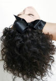 Big black bow. Hair and face photo Stock Photo